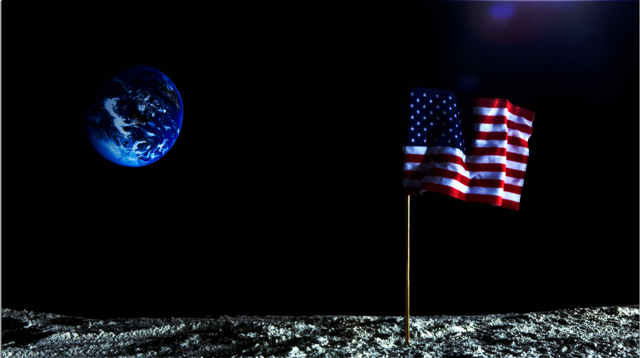 american flag on mood with earth in distance